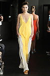 Gisele walks runway in a combo maxi slip dress from the Carlton Jones Resort 2017 collection fashion show at Le Bain in The Standard Hotel in New York City, on June 8, 2017.