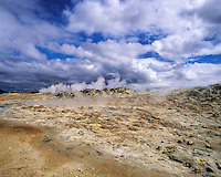 Rough, rocky landscape with geothermal fumarole and steam at Myvatn, northern Iceland