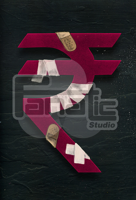 Illustrative image of rupee sign wrapped with bandage representing recession