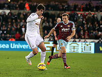 Pictured L-R: Nelson Oliveira of Swansea against Mark Noble of West Ham Saturday 10 January 2015<br /> Re: Barclays Premier League, Swansea City FC v West Ham United at the Liberty Stadium, south Wales, UK