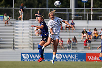 CARY, NC - SEPTEMBER 12: Lindsey Horan #10 of the Portland Thorns FC and Merritt Mathias #11 of the North Carolina Courage challenge for a header during a game between Portland Thorns FC and North Carolina Courage at Sahlen's Stadium at WakeMed Soccer Park on September 12, 2021 in Cary, North Carolina.