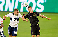 LOS ANGELES, CA - SEPTEMBER 23: Andy Rose #15 of the Vancouver Whitecaps battles with Danny Musovski #16 of LAFC during a game between Vancouver Whitecaps and Los Angeles FC at Banc of California Stadium on September 23, 2020 in Los Angeles, California.