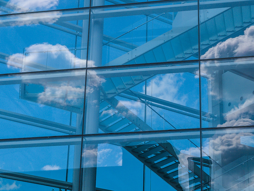 Clouds reflected in the windows of the Madison Museum of Contemporary Art on State Street in Madison, Wisconsin.