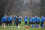 The Rangers players listen to instructions from coach Kenny McDowall