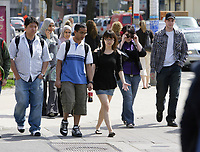 Toronto (ON) CANADA,  April , 2008-..Student of various ethnic origin walk on College street  between  University of Ontario buildings...