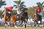 WELLINGTON, FL - JANUARY 08:  #2 Julian de Lusarreta of Coca Cola battles to take the ball from #2 Nic Roldan of the Grand Champions Polo Club, as Coca Cola teammate #4 Del Walton and #1 Grant Ganzi of Grand Champions Polo Club, look on, during the early rounds of the Joe Barry Memorial Cup, at the International Polo Club, Palm Beach on January 03, 2017 in Wellington, Florida. (Photo by Liz Lamont/Eclipse Sportswire/Getty Images)