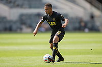 LOS ANGELES, CA - APRIL 17: Diego Palacios #12 of LAFC moves with the ball during a game between Austin FC and Los Angeles FC at Banc of California Stadium on April 17, 2021 in Los Angeles, California.