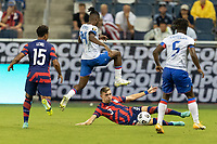 KANSAS CITY, KS - JULY 11: Sam Vines # 3 of the United States battles Leverton Pierre #14 of Haiti during a game between Haiti and USMNT at Children's Mercy Park on July 11, 2021 in Kansas City, Kansas.