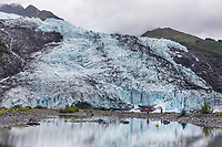 Tourists hike along the shores by Bryn Mawr glacier in College Fjord, Chugach National Forest, Prince William Sound, Alaska.