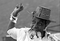 Flo Kennedy civil rights and feminist activist at Battered Women Speakout Rally on Women's Suffrage Day at Boston City Hall Plaza Boston, Massachusetts 8.26.76