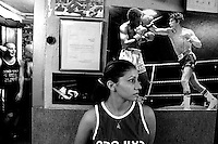 Three times Israeli champion Nili Salimov, waits to fight the Jerusalem Cup, next to the ringside in the Jerusalem Boxing Club. The club has 150 members with a majority of Israelis and a minority of Palestinians ( 15 boxers). November4, 2004.