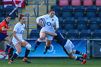 Jess Breach of England is tackled by Chloe Rollie of Scotland during the Guinness Six Nations match between England Women and Scotland Women at Castle Park Stadium, Doncaster, England on 3 April 2021. Photo by Thomas Gadd / PRiME Media Images.