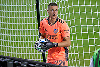 CHICAGO, UNITED STATES - AUGUST 25: Przemyslaw Tyton #22 of FC Cincinnati grabs a spare ball behind the goal net during a game between FC Cincinnati and Chicago Fire at Soldier Field on August 25, 2020 in Chicago, Illinois.
