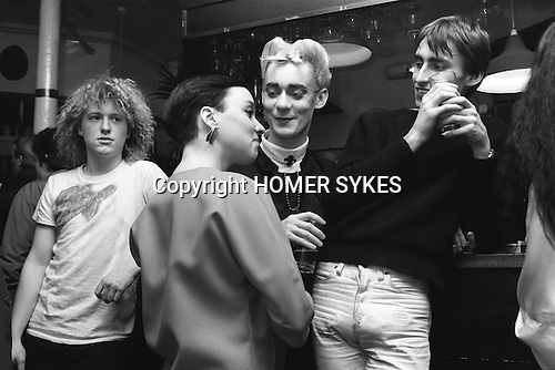 Blitz Kids New Romantics at The Blitz Club Covent Garden, London, England 1980.<br /> <br /> Jeffrey Hinton soon to be DeeJay (far left with blond curls and Tshirt) and Stephen Linard (bleach quiff.centre)