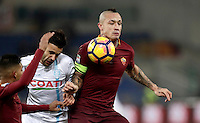 Calcio, Serie A: Roma vs ChievoVerona. Roma, stadio Olimpico, 22 settembre 2016.<br /> Chievo Verona's Ivan Radovanovic, center, fights for the ball against Roma's Emerson Palmieri, left, and Radja Nainggolan, during the Italian Serie A football match between Roma and Chievo Verona, at Rome's Olympic stadium, 22 December 2016.<br /> UPDATE IMAGES PRESS/Isabella Bonotto