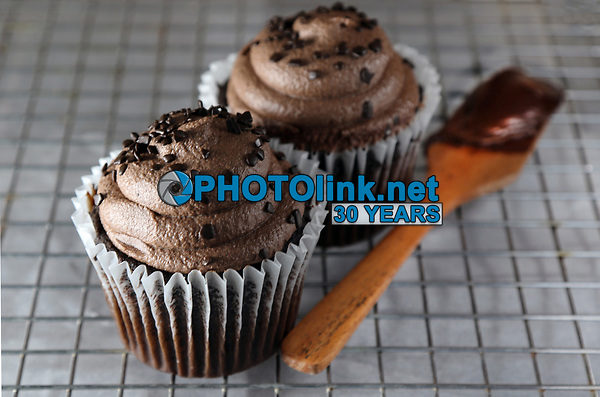Cupcakes on a cooling rack<br /> Photo By Adam Scull/PHOTOlink.net