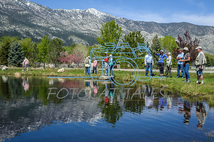"""Breast cancer survivors and their """"river buddies"""" fly fish together during the the Casting for Recovery fishing clinic at Bently Ranch in Gardnerville, Nev. May 4, 2018.<br /> Photo by Candice Vivien/Nevada Momentum"""