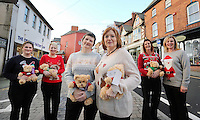 Pictured L-R: Local residents wearing Christmas jumpers Ruth Martin, Kathryn Pyart, Del Bennett, Donna Bentley, Linda Adams-Lewis and Rhian Blackford in Cardigan town centre<br /> Re: The town of Cardigan in west Wales will be temporarily renamed Jumper tomorrow (Thursday).