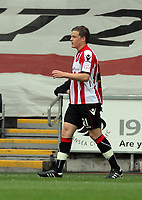 Pictured: Shane Lowry of Sheffield United sent off after shown a red card by refereeE L Ilderton for saving the ball with his hand from a kick by Scott Sinclair of Swansea which earned the latter team with a penalty scored by the same player. Saturday 07 May 2011<br /> Re: Swansea City FC v Sheffield United, npower Championship at the Liberty Stadium, Swansea, south Wales.