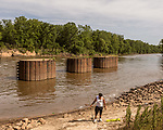 May 4, 2018. Fayetteville, North Carolina.<br /> <br /> Orrion Hill sets up fishing poles at the William O Huske Dam. This is the dam closest to the Chemours plant.<br /> <br /> The Chemours Company, a spin off from DuPont, manufactures many chemicals at its plant in Fayetteville, NC. One of these, commonly referred to as GenX, is part of the process of teflon manufacturing. Chemours has been accused of dumping large quantities of GenX into the Cape Fear River and polluting the water supply of city's down river and allowing GenX to leak into local aquifers.