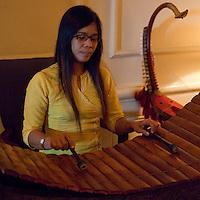 Myanmar, Burma, Yangon.  Musician Playing the Xylophone in a Hotel Lobby.