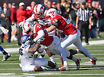 Southern Methodist Mustangs linebacker STEPHON SANDERS (23) and Southern Methodist Mustangs linebacker CAMERON RODGERS (50) tackle Memphis Tigers running back JAI STEIB (32) during the game between the Memphis Tigers and the Southern Methodist Mustangs at the Gerald J. Ford Stadium in Dallas, Texas. Memphis defeats SMU 48 to 3...