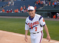 Head coach Jack Leggett (7) of the Clemson Tigers hears the cheers from the fans after the Tigers defeated the Elon College Phoenix on March 21, 2012, at Fluor Field at the West End in Greenville, South Carolina. Clemson's 4-2 win gave Leggett his 1,200th career win. (Tom Priddy/Four Seam Images)