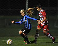 20131001 - VARSENARE , BELGIUM :  Brugge's Silke Demeyere pictured with Antwerp Charlotte Andries in her back (right) during the female soccer match between Club Brugge Vrouwen and Royal Antwerp FC Ladies , of the fifth matchday in the BENELEAGUE competition. Tuesday 1 October 2013. PHOTO DAVID CATRY