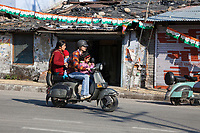India, Dehradun.  Family on a Motorbike--Helmet for the Man, none for the rest.