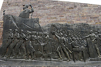 ETHIOPIA , Addis Ababa, The Tiglachin Monument, also known as Derg Monument at Churchill Avenue, Derg was the communist regime under dictator Mengistu Haile Mariam, is a memorial to Ethiopian and Cuban soldiers involved in the Ogaden War between Somalia and Ethiopia, inaugurated on 12 September 1984, the statuary was donated by North Korea, and was manufactured by the Mansudae Art Studio, wall relief with worker, farmer and soldier leaded by the dictator / AETHIOPIEN, Addis Abeba, Monument aus der kommunistischen Derg Zeit