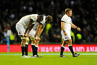 (L-R) Courtney Lawes, Geoff Parling and Tom Youngs of England look dejected after losing the QBE Autumn International match between England and New Zealand at Twickenham on Saturday 16th November 2013 (Photo by Rob Munro)