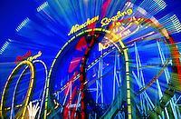 Carnival rides at twilight for Oktoberfest Munich Germany