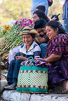 Chichicastenango, Guatemala.  Quiche (Kiche, K'iche') Family Sitting on Steps of Santo Thomas Church, Sunday Morning.