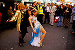 "Ann Barr editor writer on ""Sloane Rangers"" dancing with belly dancer. Motcomb Street annual Street Party Belgravia London SW1 1998.<br />