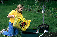 TT19-048z  Girl mixing fertilizer for planting tree - (TT19-004e,047z,048z,050z,051z,053z,056z,059z)