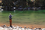 Caucasian fly fisherman, angler, at Maroon Lake in the Maroon Bells Snowmass Wilderness Area, near Aspen, Colorado.