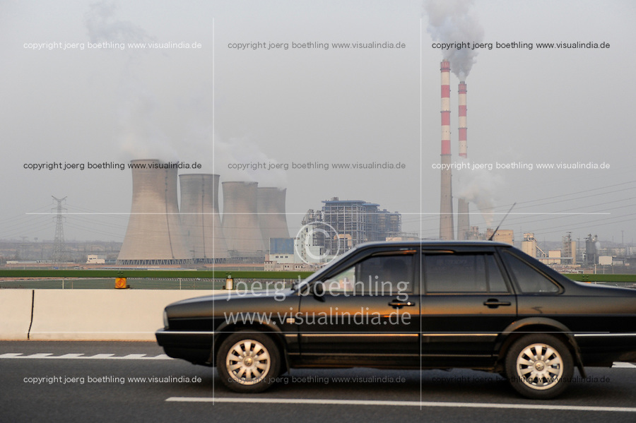 CHINA, Province Shaanxi, city Xian, coal power station and VW Volkswagen Santana on highway