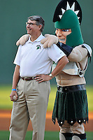USC Upstate Chencellor Tom Moore poses with the Spartan mascot before throwing out the first pitch before a game against the South Carolina Gamecocks on Tuesday, March 15, 2016, at Fluor Field at the West End in Greenville, South Carolina. (Tom Priddy/Four Seam Images)