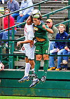 12 September 2010: University of Vermont Catamount defender Sean Sweeney, a Sophomore from Cromwell, CT, goes up for a header against Tyler Regan during action against the Cornell University Big Red at Centennial Field in Burlington, Vermont. The Catamounts defeated the Big Red 2-1. Mandatory Credit: Ed Wolfstein Photo