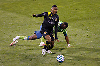 COLUMBUS, OH - DECEMBER 12: Nouhou #5 of Seattle Sounders FC loses his shoe while battling for the ball against Luis Diaz #12 of Columbus Crew during a game between Seattle Sounders FC and Columbus Crew at MAPFRE Stadium on December 12, 2020 in Columbus, Ohio.