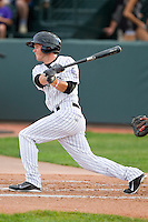Matt Wessinger (12) of the Grand Junction Rockies follows through on his swing against the Billings Mustangs at Suplizio Field on July 24, 2012 in Grand Junction, Colorado.  The Rockies defeated the Mustangs 4-3.  (Brian Westerholt/Four Seam Images)