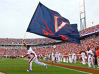 Sept. 3, 2011 - Charlottesville, Virginia - USA; Virginia Cavaliers cheerleaders run with the school flag during an NCAA football game against William & Mary at Scott Stadium. Virginia won 40-3. (Credit Image: © Andrew Shurtleff
