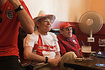 Older English World Cup football fans Southend on Sea Essex England  2006.  2000s drink ing beer through a straw