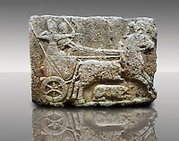 Picture & image of a Neo-Hittite orthostat with a chariot Releif sculpture from Karkamis,, Turkey. Museum of Anatolian Civilisations, Ankara. The Cahiot is pulled by horses with plumed headresses. One man os about to shoot an arrow from his bow, the other man is driving the cahriot. Below the horse is a animal cowering.