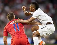 KANSAS CITY, KS - JUNE 26: Kevin Galvan #6 challenges Jordan Morris #11 for a header during a game between United States and Panama at Children's Mercy Park on June 26, 2019 in Kansas City, Kansas.