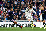 Luka Modric of Real Madrid (R) in action against Jose Ignacio Martinez Garcia, Nacho, of Real Valladolid during the La Liga 2018-19 match between Real Madrid and Real Valladolid at Estadio Santiago Bernabeu on November 03 2018 in Madrid, Spain. Photo by Diego Souto / Power Sport Images