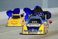Nov. 13, 2011; Pomona, CA, USA; NHRA funny car driver Ron Capps (near lane) alongside Jeff Arend during the Auto Club Finals at Auto Club Raceway at Pomona. Mandatory Credit: Mark J. Rebilas-.