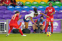 ORLANDO CITY, FL - FEBRUARY 18: Margaret Purce #20 of the United States tumbles with the ball during a game between Canada and USWNT at Exploria Stadium on February 18, 2021 in Orlando City, Florida.