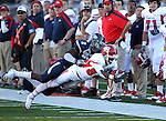 Nevada defender Khalid Wooten (2) breaks up a play against Fresno State receiver A.J. Johnson (82) during an NCAA football game in Reno, Nev., on Saturday, Oct. 21, 2011. Nevada won 45-38. (AP Photo/Cathleen Allison)