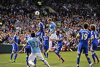 Edin Dzeko (10) Manchester City heads the ball at the Chelsea goal..Manchester City defeated Chelsea 4-3 in an international friendly at Busch Stadium, St Louis, Missouri.